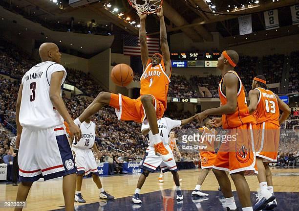 Hakim Warrick of the Syracuse Orangemen dunks against the UCONN Huskies on February 2 2004 at the Hartford Civic Center in Hartford Connecticut UCONN...