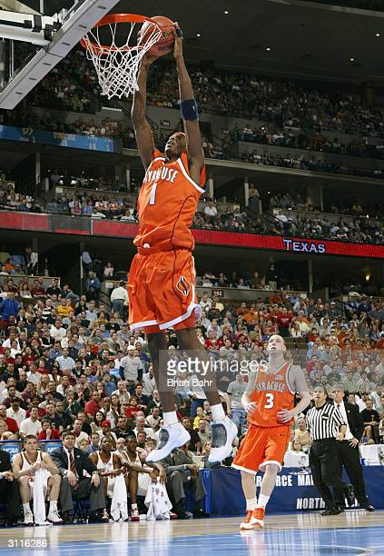 Hakim Warrick of the Syracuse Orangemen gets an uncontested dunk against the Maryland Terrapins during their second round game of the NCAA Division I...