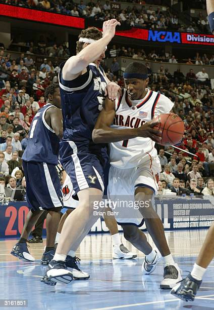 Hakim Warrick of the Syracuse University Orangeman drives around Jake Shoff of the Brigham Young University Cougars during a first round game of the...