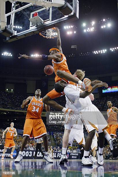 Hakim Warrick of the Syracuse University Orangeman dunks over Royal Ivey of the University of Texas at Austin Longhorns during the semifinal round of...