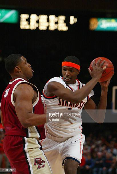 Hakim Warrick of the Syracuse University Orangemen is defended by Craig Smith of the Boston College Eagles during the Quarterfinal game of the Big...