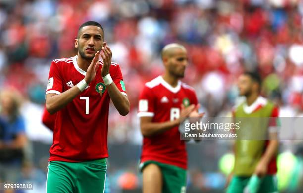 Hakim Ziyach of Morocco acknowledges the fans afer his team's elimination following the 2018 FIFA World Cup Russia group B match between Portugal and...