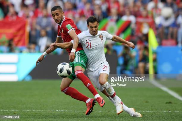 Hakim Ziyach of Morocco battles for possession with Cedric of Portugal during the 2018 FIFA World Cup Russia group B match between Portugal and...