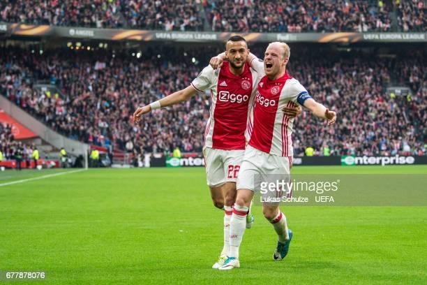 Hakim Ziyech and Davy Klaassen of Amsterdam celebrate their teams first goal during the Uefa Europa League semi final first leg match between Ajax...