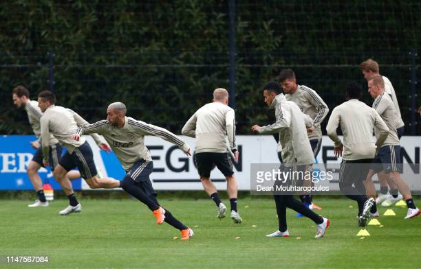 Hakim Ziyech and Noussair Mazraoui take part in a drill during an Ajax training session on the eve of their UEFA Champions League semi final against...