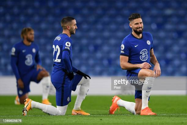 Hakim Ziyech and Olivier Giroud of Chelsea takes a knee in support of the Black Lives Matter movement during the Premier League match between Chelsea...