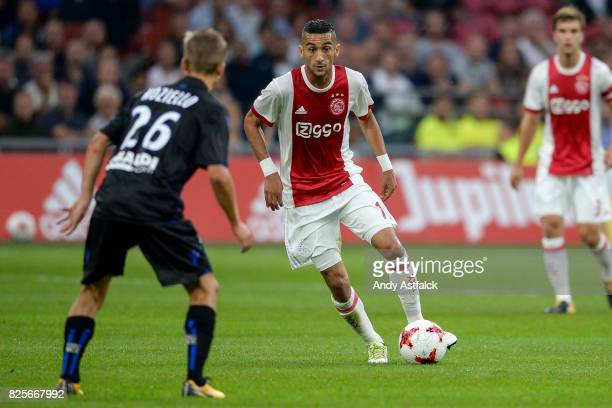 Hakim Ziyech from AJAX with the ball while Vincent Koziello from OSC Nice defends during the UEFA Champions League Qualifying Third Round Second Leg...