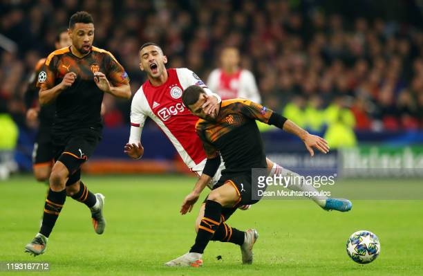 Hakim Ziyech of AFC Ajax and Jose Luis Gaya of Valencia during the UEFA Champions League group H match between AFC Ajax and Valencia CF at Amsterdam...