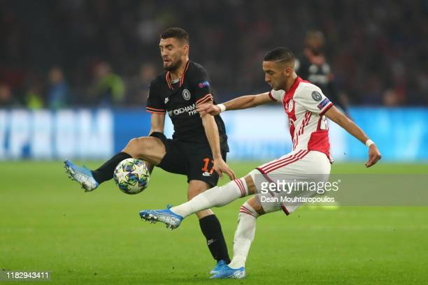 Hakim Ziyech of AFC Ajax is put under pressure by Mateo Kovacic of Chelsea during the UEFA Champions League group H match between AFC Ajax and...