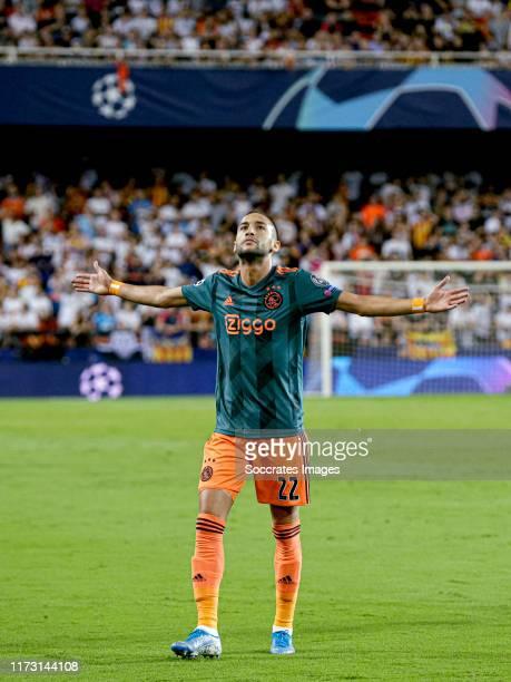 Hakim Ziyech of Ajax celebrates 0-1 during the UEFA Champions League match between Valencia v Ajax at the Estadio de Mestalla on October 2, 2019 in...