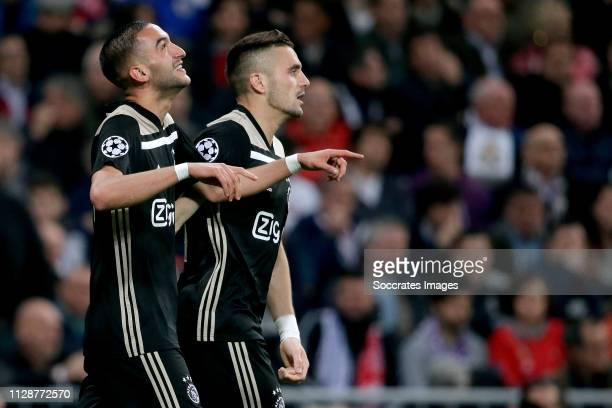Hakim Ziyech of Ajax celebrates 01 with Dusan Tadic of Ajax during the UEFA Champions League match between Real Madrid v Ajax at the Santiago...