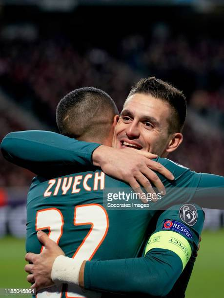Hakim Ziyech of Ajax celebrates 01 with Dusan Tadic of Ajax during the UEFA Champions League match between Lille v Ajax at the Stade Pierre Mauroy on...