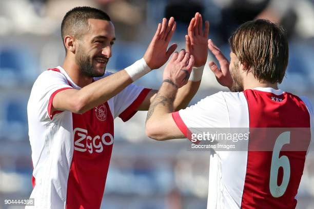 Hakim Ziyech of Ajax celebrates 10 with Lasse Schone of Ajax during the match between Ajax v Lyngby BK at the Estadio Municipal on January 13 2018 in...