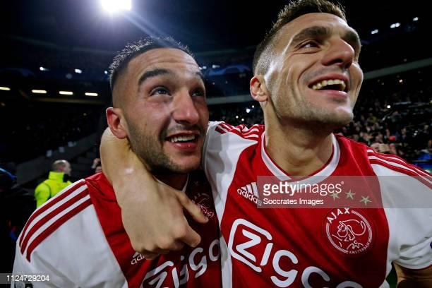 Hakim Ziyech of Ajax celebrates 11 with Dusan Tadic of Ajax during the UEFA Champions League match between Ajax v Real Madrid at the Johan Cruijff...