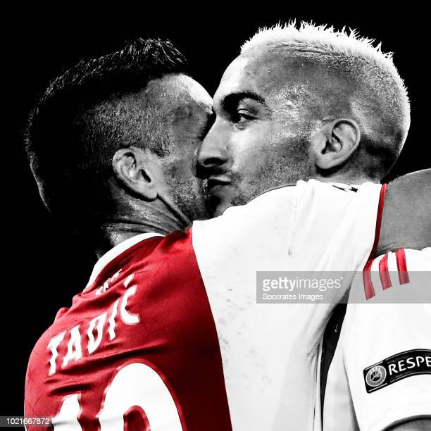 Hakim Ziyech of Ajax celebrates 21 with Dusan Tadic of Ajax during the UEFA Champions League match between Ajax v Dinamo Kiev at the Johan Cruijff...