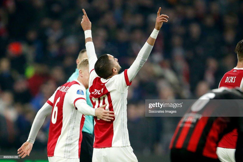 Hakim Ziyech of Ajax celebrates 3-1 with Donny van de Beek of Ajax during the Dutch Eredivisie match between Ajax v Excelsior at the Johan Cruijff Arena on December 14, 2017 in Amsterdam Netherlands