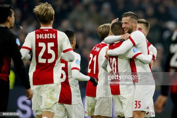 Hakim Ziyech of Ajax celebrates 31 with Justin Kluivert of Ajax Frenkie de Jong of Ajax Mitchell Dijks of Ajax Joel Veltman of Ajax during the Dutch...