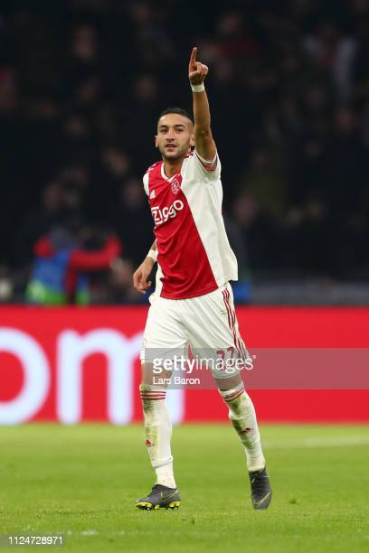 Hakim Ziyech of Ajax celebrates after scoring his team's first goal during the UEFA Champions League Round of 16 First Leg match between Ajax and...