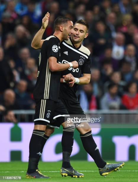 Hakim Ziyech of Ajax celebrates after scoring his team's first goal with Dusan Tadic during the UEFA Champions League Round of 16 Second Leg match...