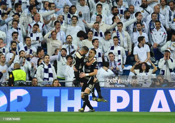Hakim Ziyech of Ajax celebrates after scoring his team's first goal with Dusan Tadic in front of Real Madrid fans during the UEFA Champions League...