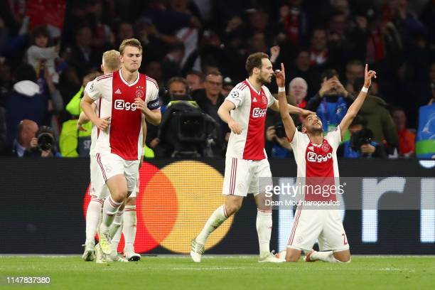 Hakim Ziyech of Ajax celebrates after scoring his team's second goal with Daley Blind of Ajax during the UEFA Champions League Semi Final second leg...