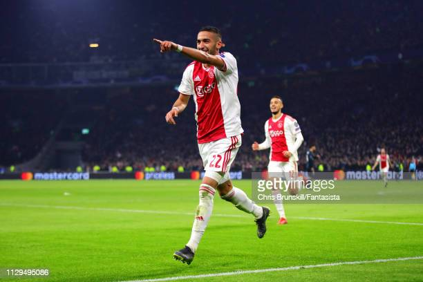Hakim Ziyech of Ajax celebrates scoring his sides first goal during the UEFA Champions League Round of 16 First Leg match between Ajax and Real...