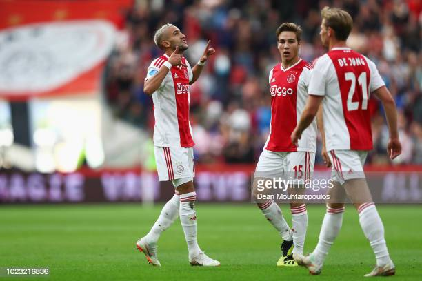 Hakim Ziyech of Ajax celebrates scoring his teams first goal of the game with team mates Carel Eiting and Frenkie de Jong during the Eredivisie match...