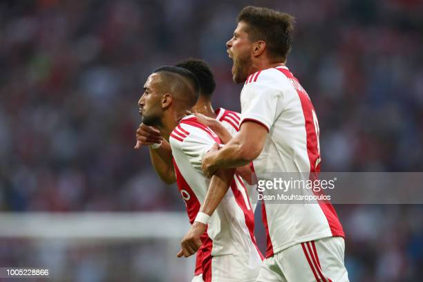 Hakim Ziyech of Ajax celebrates with team mates after scoring his team's first goal during the first leg UEFA Champions League Qualifier match...