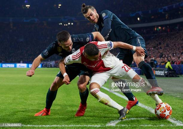 Hakim Ziyech of Ajax competes for the ball with Daniel Carvajal of Real Madrid and Gareth Bale of Real Madrid during the UEFA Champions League Round...