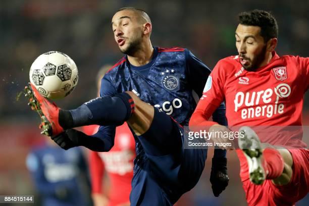 Hakim Ziyech of Ajax Cristian Cuevas of FC Twente during the Dutch Eredivisie match between Fc Twente v Ajax at the De Grolsch Veste on December 2...
