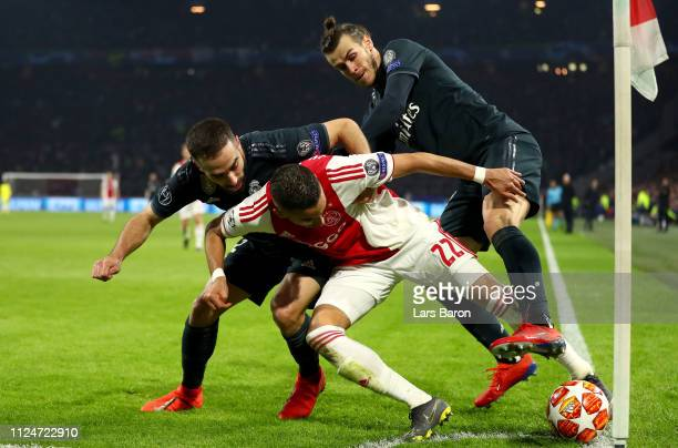 Hakim Ziyech of Ajax is challenged by Daniel Carvajal of Real Madrid and Gareth Bale of Real Madrid during the UEFA Champions League Round of 16...