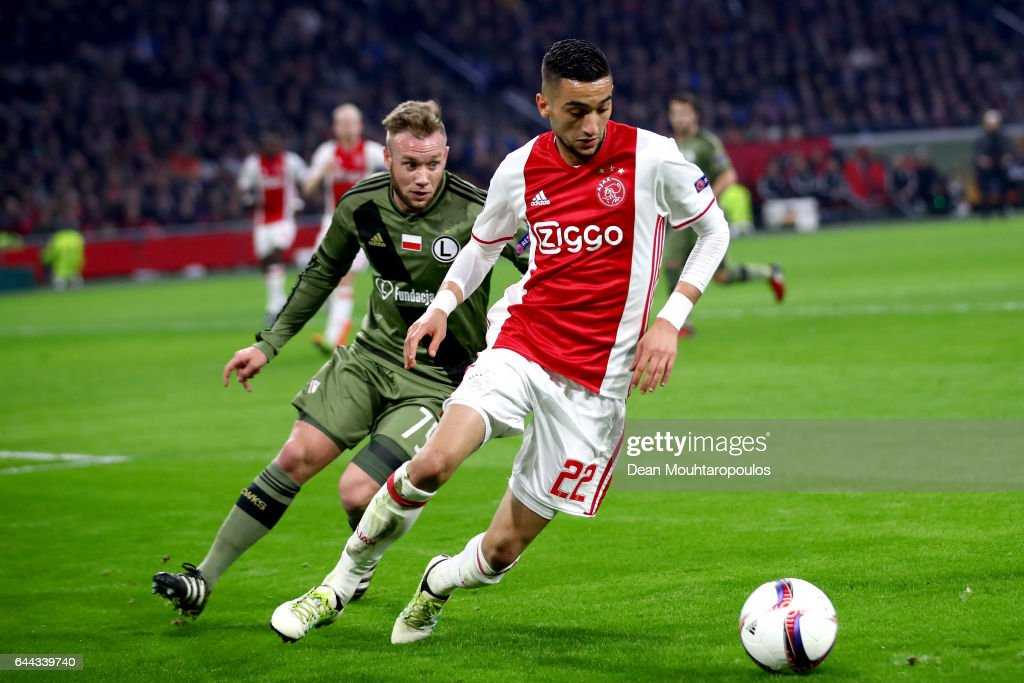 Hakim Ziyech of Ajax is watched by Mihail Aleksandrov of Legia Warszawa during the UEFA Europa League Round of 32 second leg match between Ajax Amsterdam and Legia Warszawa at Amsterdam Arena on February 23, 2017 in Amsterdam, Netherlands.