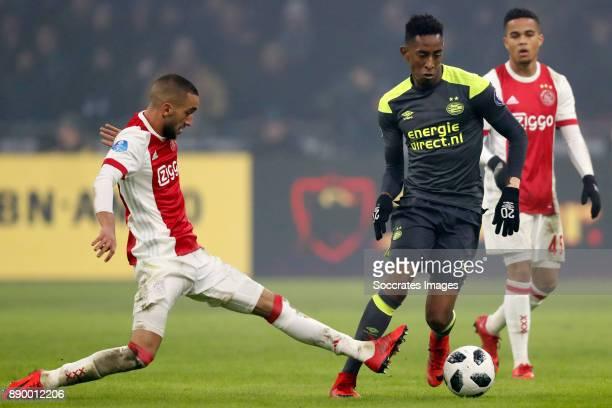 Hakim Ziyech of Ajax Joshua Brenet of PSV during the Dutch Eredivisie match between Ajax v PSV at the Johan Cruijff Arena on December 10 2017 in...
