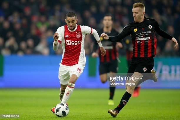 Hakim Ziyech of Ajax Mike van Duinen of Excelsior during the Dutch Eredivisie match between Ajax v Excelsior at the Johan Cruijff Arena on December...