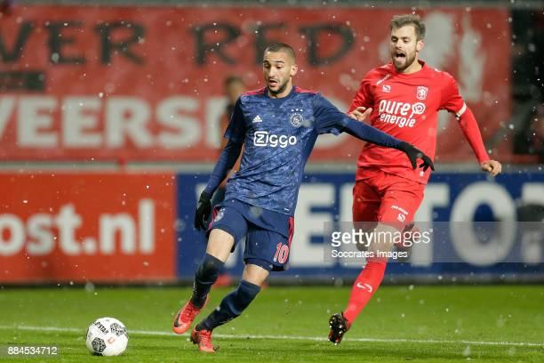 Hakim Ziyech of Ajax Stefan Thesker of FC Twente during the Dutch Eredivisie match between Fc Twente v Ajax at the De Grolsch Veste on December 2...
