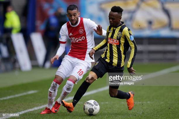 Hakim Ziyech of Ajax Thulani Serero of Vitesse during the Dutch Eredivisie match between Vitesse v Ajax at the GelreDome on March 4 2018 in Arnhem...