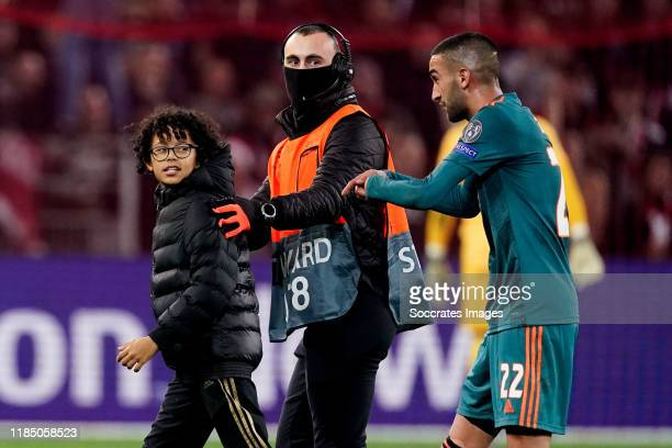 Hakim Ziyech of Ajax with supporter during the UEFA Champions League match between Lille v Ajax at the Stade Pierre Mauroy on November 27, 2019 in...