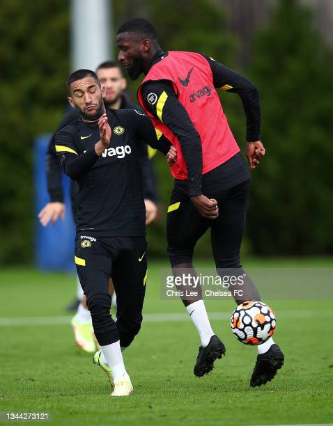 Hakim Ziyech of Chelsea and Antonio Rudiger of Chelsea in action during the Chelsea Training session at Chelsea Training Ground on October 01, 2021...