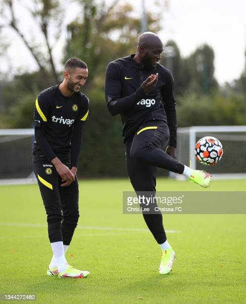 Hakim Ziyech of Chelsea and Romelu Lukaku of Chelsea during the Chelsea Training session at Chelsea Training Ground on October 01, 2021 in Cobham,...