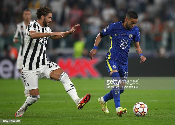 Hakim Ziyech of Chelsea battles for possession with Manuel Locatelli of Juventus during the UEFA Champions League group H match between Juventus and...