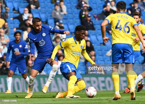 Hakim Ziyech of Chelsea battles for possession with Yves Bissouma of Brighton and Hove Albion during the preseason friendly between Brighton Hove...