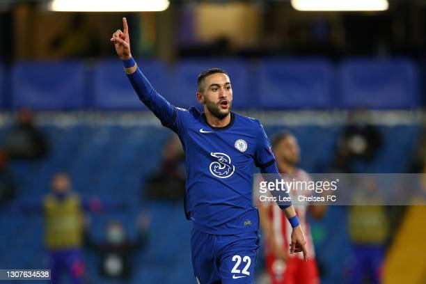 Hakim Ziyech of Chelsea celebrates after scoring their team's first goal during the UEFA Champions League Round of 16 match between Chelsea FC and...