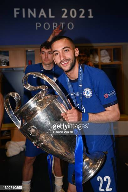 Hakim Ziyech of Chelsea celebrates in the dressing room with the Champions League Trophy after winning the UEFA Champions League Final between...