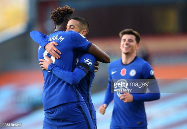 Hakim Ziyech of Chelsea celebrates with teammate Tammy Abraham after scoring his team's first goal during the Premier League match between Burnley...
