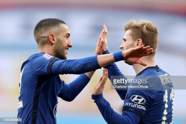Hakim Ziyech of Chelsea celebrates with teammate Timo Werner of Chelsea after scoring their 1st goal during the Semi Final of the Emirates FA Cup...