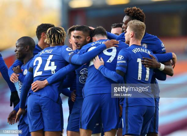 Hakim Ziyech of Chelsea celebrates with teammates after scoring his team's first goal during the Premier League match between Burnley and Chelsea at...