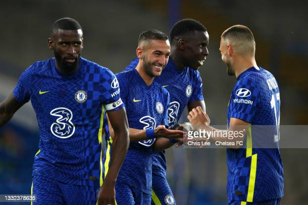 Hakim Ziyech of Chelsea celebrates with teammates Antonio Rudiger, Mateo Kovacic and Kurt Zouma after scoring his sides second goal during the Pre...