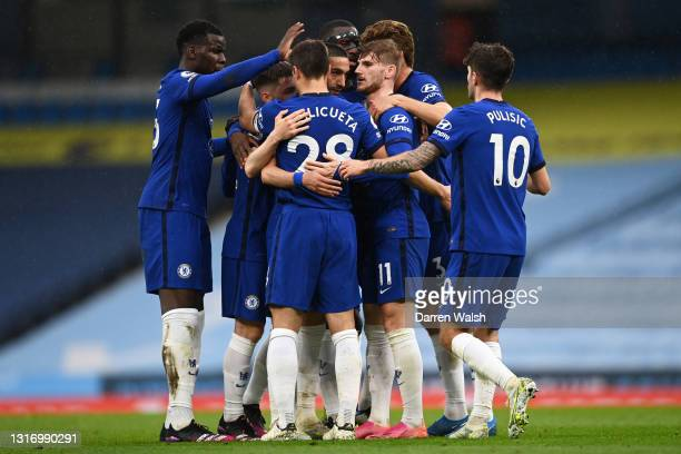 Hakim Ziyech of Chelsea celebrates with Timo Werner and team mates after scoring their side's first goal during the Premier League match between...