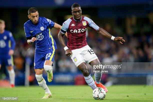 Hakim Ziyech of Chelsea gives chase to Marvelous Nakamba of Aston Villa during the Carabao Cup Third Round match between Chelsea and Aston Villa at...