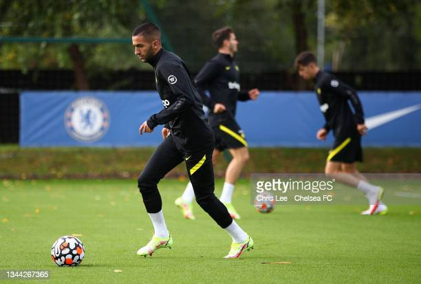 Hakim Ziyech of Chelsea in action at Chelsea Training Ground on October 01, 2021 in Cobham, England.